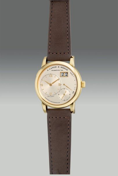 A. Lange & Söhne A fine and elegant yellow gold wristwatch with eccentric time a…