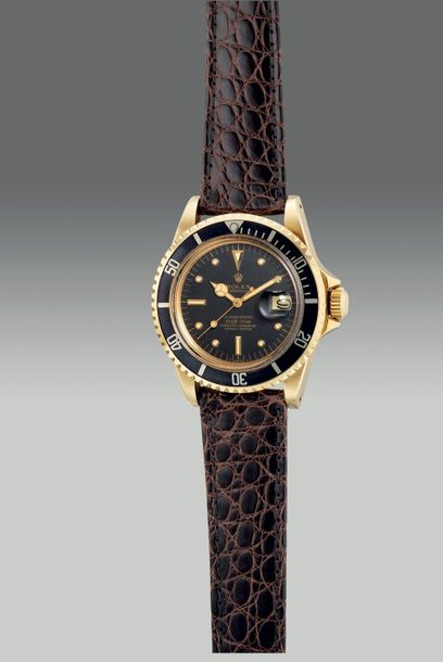 Rolex A fine and attractive yellow gold diver's wristwatch with center seconds, …