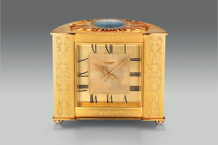 Patek Philippe An attractive and well preserved gilt brass engraved solar Pendul…