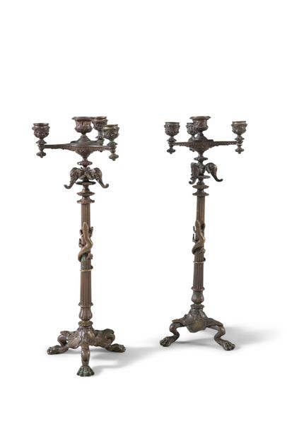 A PAIR OF BRONZE FOUR LIGHT CANDELABRA, in the Empire taste, the campagna urn sh…