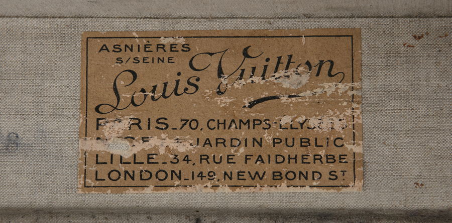 A LOUIS VUITTON TAN LEATHER 'MALLE' SUITCASE, c.1920s, with stamped fitted lock …