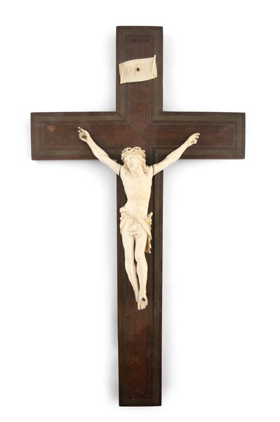 A LATE 19TH CENTURY FRENCH CRUCIFIX, the carved ivory (probably Dieppe) figure o…