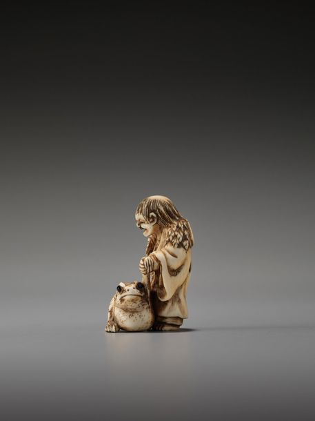 AN IVORY NETSUKE OF GAMA SENNIN WITH LARGE TOAD Unsigned Japan, 19th century, Ed…