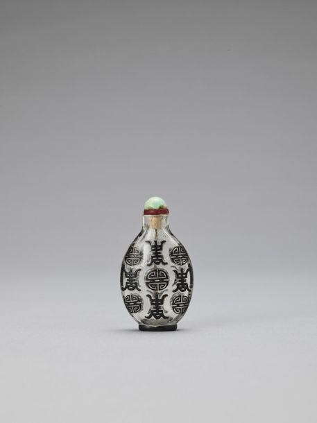 A BLACK OVERLAY GLASS 'SHOU' SNUFF BOTTLE, QING China, 1644 1912. The snuff bott…