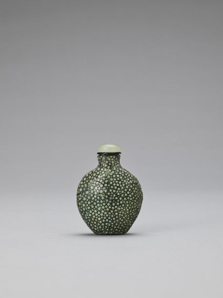 A RARE SHAGREEN COVERED GLASS SNUFF BOTTLE, QING China, 1644 1912. The snuff bot…