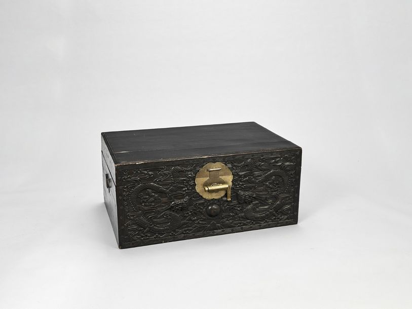 A PAIR OF HARDWOOD DRAGON CHESTS, QING China, 1644 1912. The chests carved with …