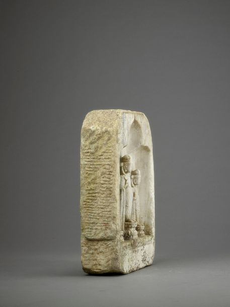 A WHITE MARBLE BUDDHIST STELE, NORTHERN QI DYNASTY China, 550 577. Carved from o…