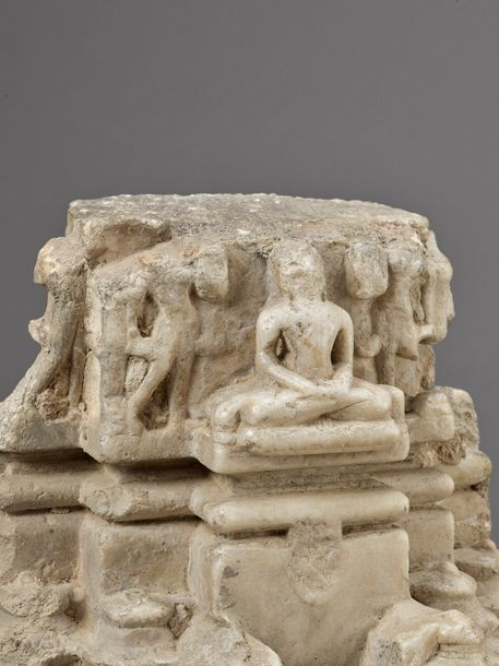 A JAIN WHITE MARBLE ARCHITECTURAL FRAGMENT OF A PARIKARA, EARLY 13TH CENTURY Ind…