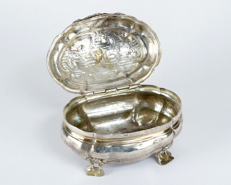 German Baroque Silver Box, in oval shape, stepped and bowed, on four open work f…