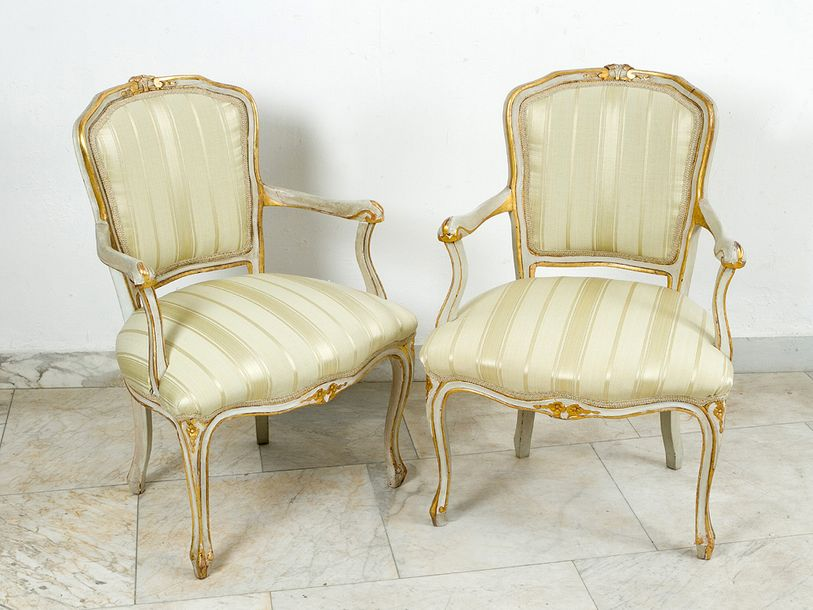 Pair of armchairs, in Baroque shape; each on four legs with two hand rests; with…