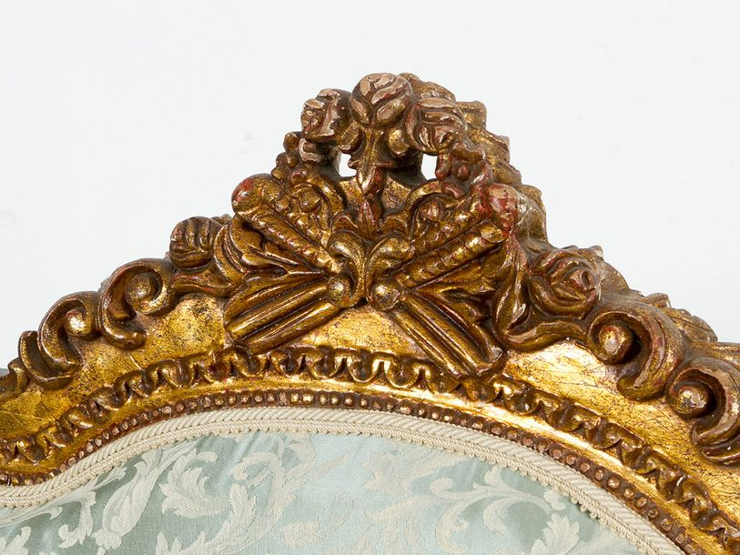Pair of gilded armchairs in Louis XVI manner, on four feet, with two hand rests;…