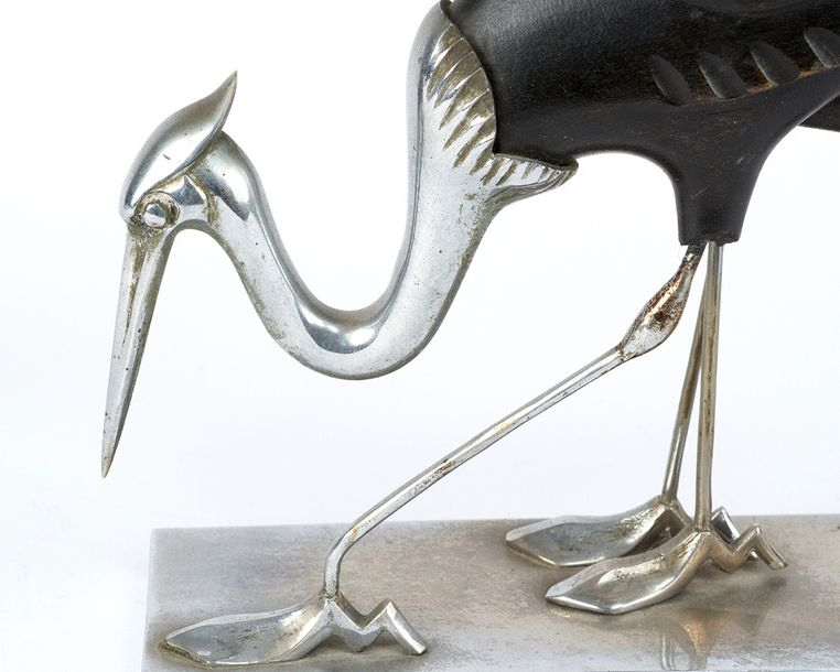 Art Deco Sculpture, two cranes, ebonised carved wood and chromed metal, on recta…