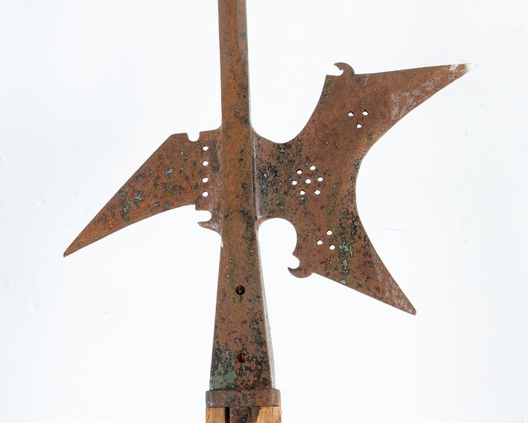 Halberd, iron forged with open work and peak finial; rusty; on later wooden stic…