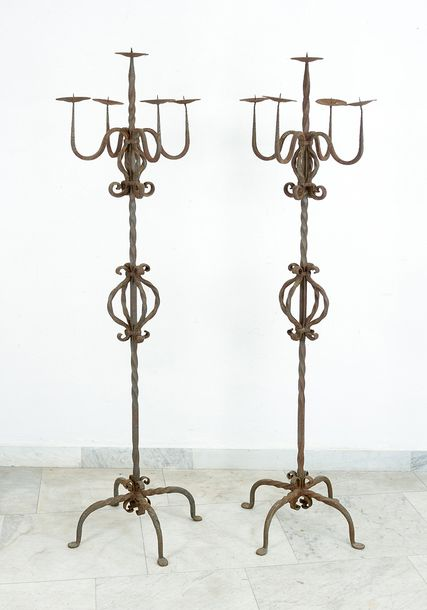 Pair of Hall Candelabras, rough forged iron, each for five candles with tazzas; …