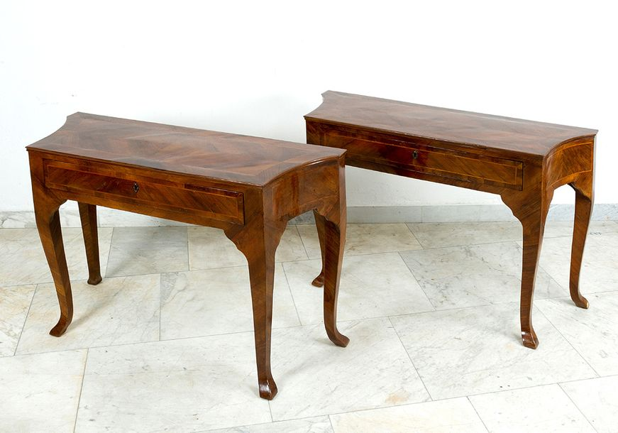 Pair of Venetian console tables; each on four long curved legs, one drawer, bowe…