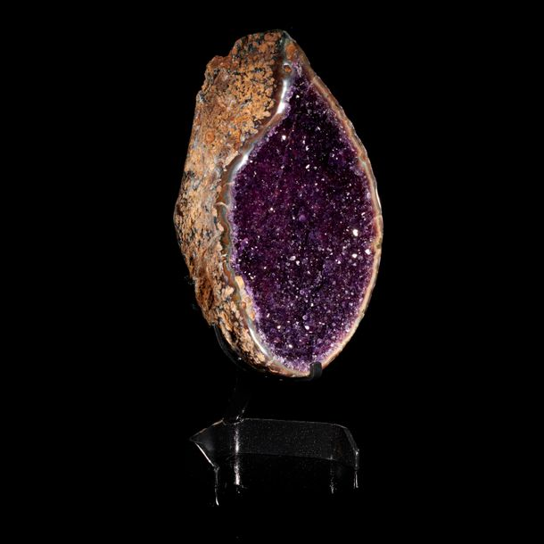 Minerals: An amethyst geode, Uruguay, on stand, 47cm high overall