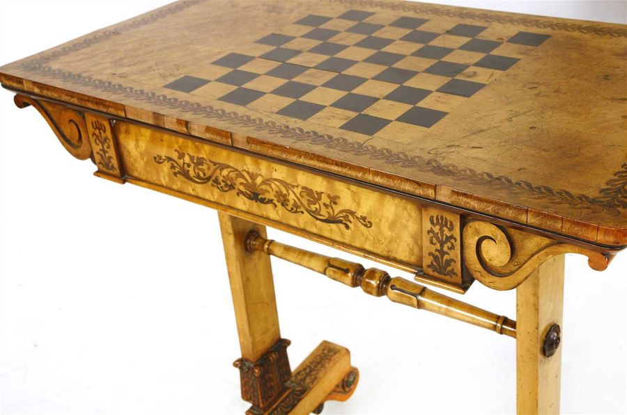 A Regency burr maple games table, in the manner of Morel & Seddon, the rectangul…