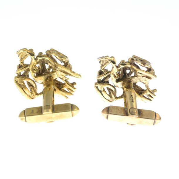 A pair of 1960s 9ct gold textured cufflinks.Hallmarks for London, 1965.Length of…