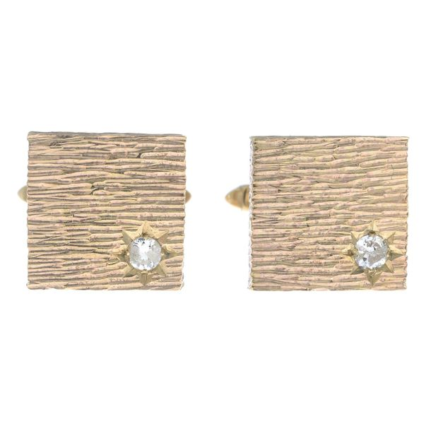A pair of 9ct gold brilliant cut diamond accent textured cufflinks.Estimated tot…