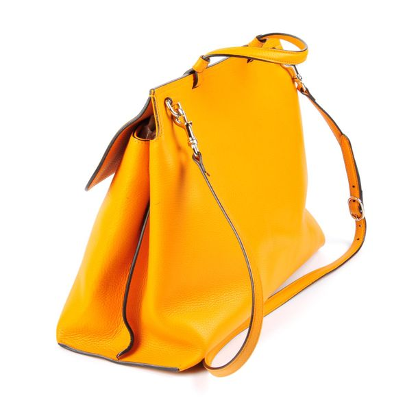 GUCCI a Bamboo Daily Top Handle handbag. Designed with a pebbled mustard yellow …
