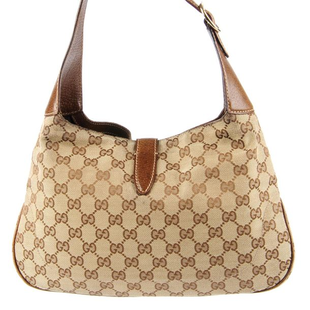 GUCCI a Jackie handbag. Featuring maker's GG canvas exterior, pebbled brown leat…