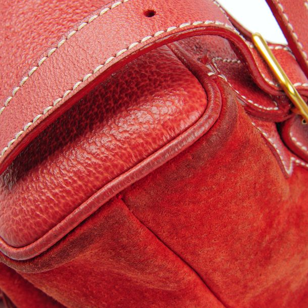 GUCCI a red suede and leather bamboo backpack. Featuring a top flap closure with…