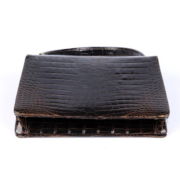 GUCCI a vintage crocodile handbag. Designed with a structured shape, crafted fro…