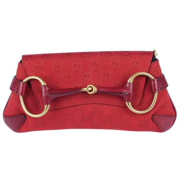 GUCCI a red canvas Horsebit clutch. Designed with maker's red monogram canvas ex…