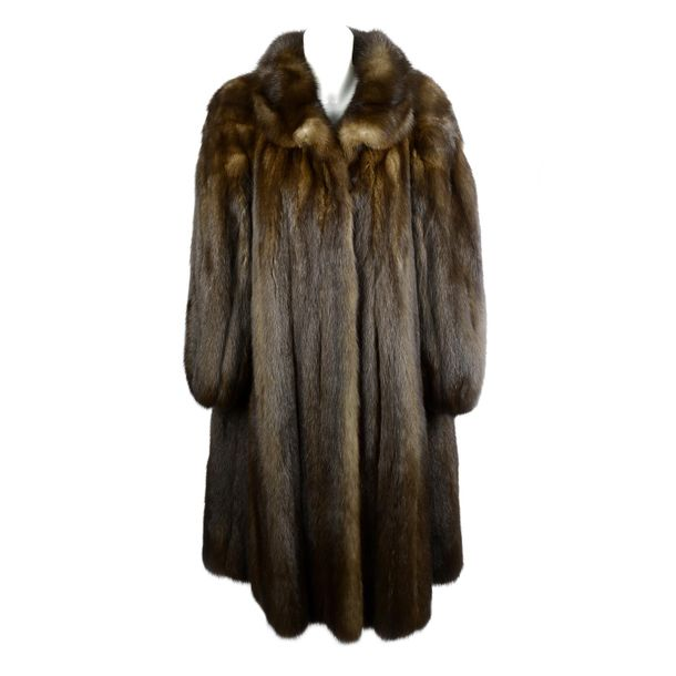YVES SAINT LAURENT a full length sable fur coat. Designed with a short lapel col…