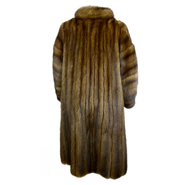 A full length sable fur coat. Designed with a short lapel collar, hook and eye c…