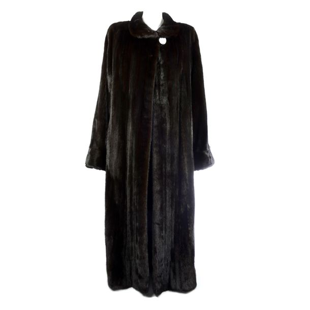 A full length dark ranch mink coat. Designed with a short collar, single button …