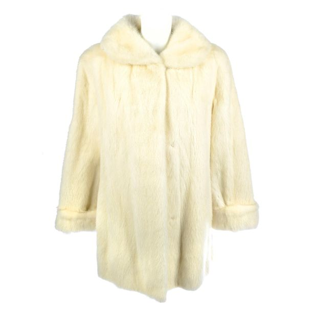 A three quarter length pearl mink fur coat. Designed with a peter pan collar, co…