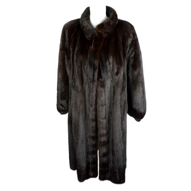 A dark ranch mink coat. Designed with a short Mandarin collar with mink tail tie…