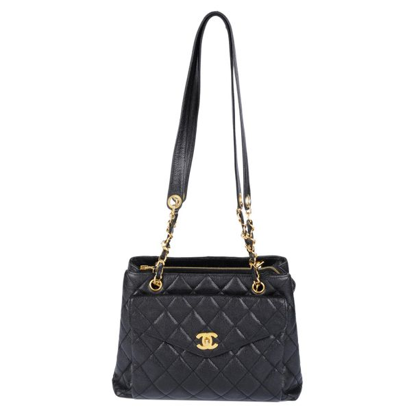 CHANEL a quilted Caviar leather handbag. Featuring a diamond quilted black cavia…