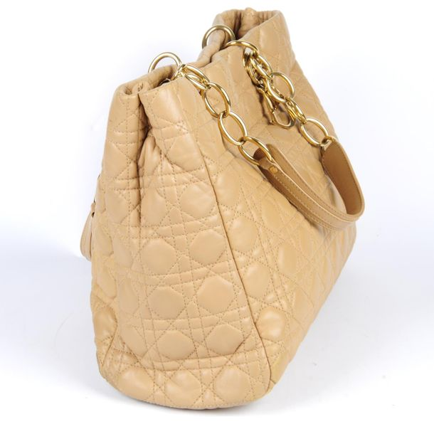 CHRISTIAN DIOR a beige Cannage handbag. Designed with maker's signature quilted …