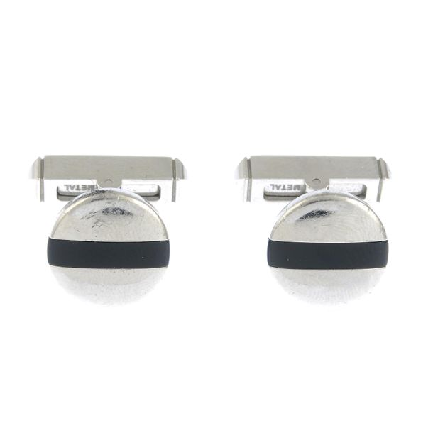 A pair of silver onyx cufflinks, by Cartier. Swiss convention marks. Diameter of…