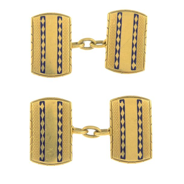 A pair of mid 20th century enamel cufflinks.Length 1.9cms. 6.5gms. Overall condi…