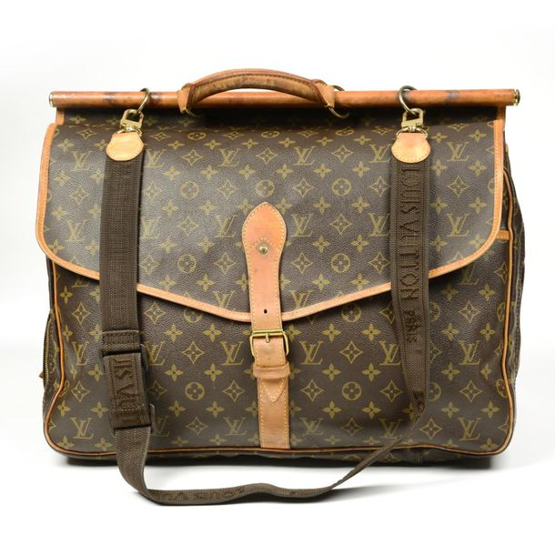 LOUIS VUITTON a Monogram Sac Chasse travel bag. Designed with maker's monogram c…