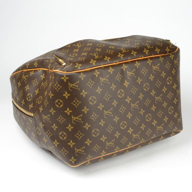 LOUIS VUITTON a Monogram Evasion travel bag. Featuring a monogram coated canvas …