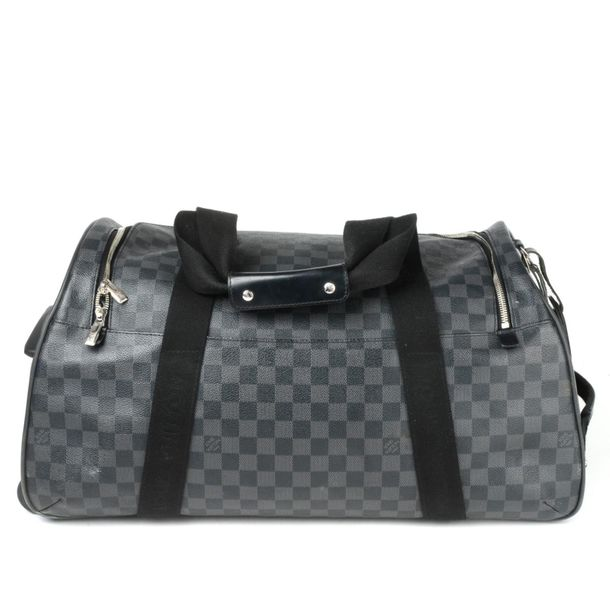 LOUIS VUITTON a Damier Graphite Neo Eole 55 rolling duffle bag. Designed with ma…