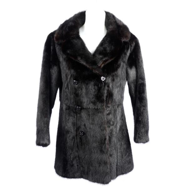 A black mink coat. Designed with a notched lapel collar, double breasted button …