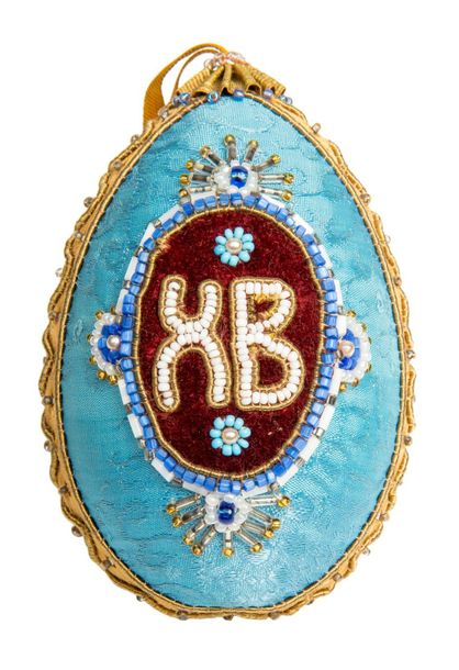 Two russian porcelain eggs Russian porcelain egg in fabric decorated with cross …