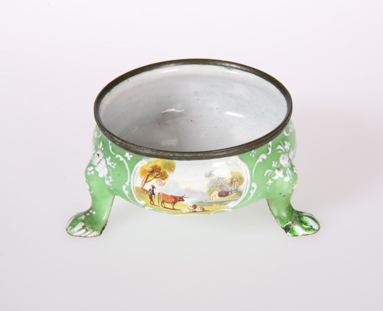 AN ENGLISH GREEN ENAMEL SALT CELLAR, decorated with three scroll bordered cartou…