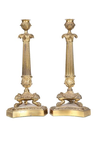 A PAIR OF GILT METAL COLUMNAR LAMP BASES IN THE EMPIRE TASTE, each candle cup ab…