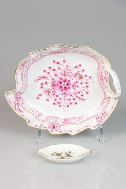 A lot with (2) porcelain items consisting of an ashtray and a small saucer with …