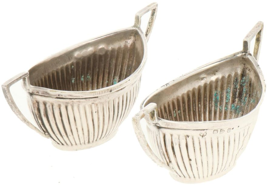 (2) Piece set salt cellars silver. Boat shaped with cannelures and soldered hand…