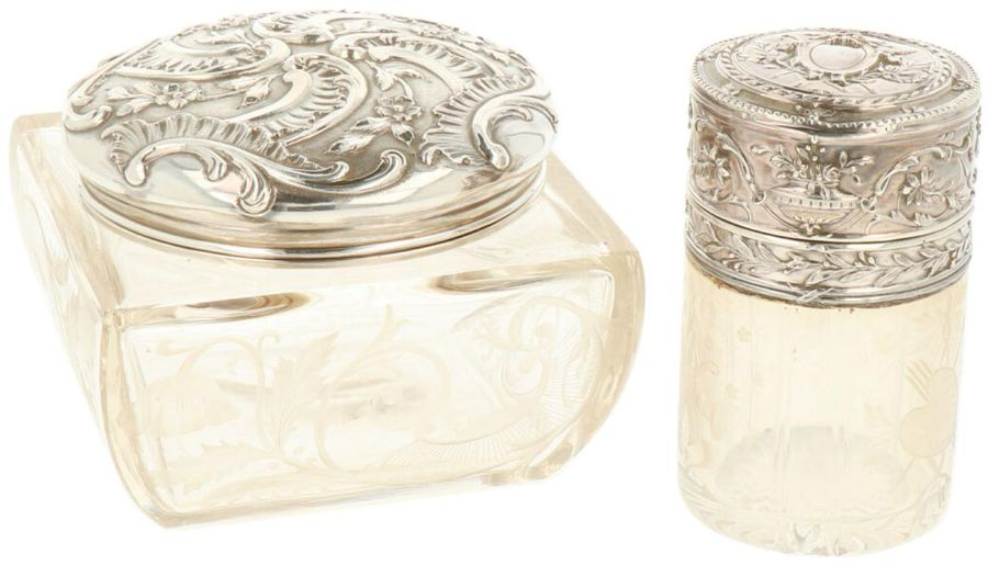 (2) Piece lot of toilet table flasks silver. Executed with engraved glass and ch…