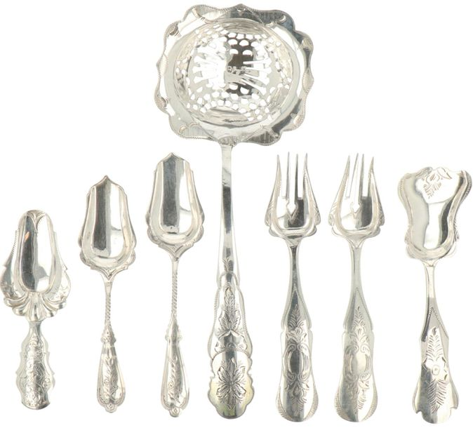 (7) Piece lot with various silver items. A.W. Casting spoon (with restoration) s…