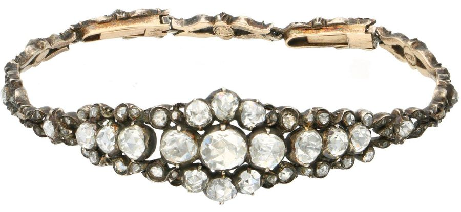 Yellow gold antique bracelet, with diamond 14 ct. Two closures with safety clip.…