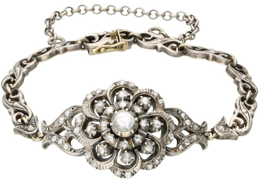 Gold / silver bracelet, with diamond 14 ct. And 925/1000. Closure with safety cl…